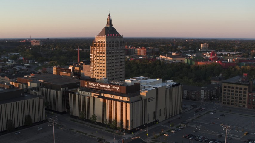 5.7K stock footage aerial video of orbiting a college and Kodak Tower at sunset, Rochester, New York Aerial Stock Footage | DX0002_209_037