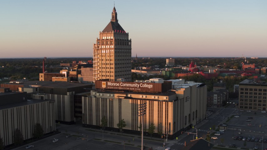 5.7K stock footage aerial video of orbiting Kodak Tower and a college at sunset, Rochester, New York Aerial Stock Footage | DX0002_209_039