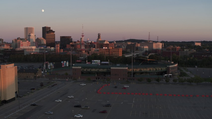 5.7K stock footage aerial video a stationary view of the baseball stadium at sunset, Downtown Rochester, New York Aerial Stock Footage | DX0002_209_047
