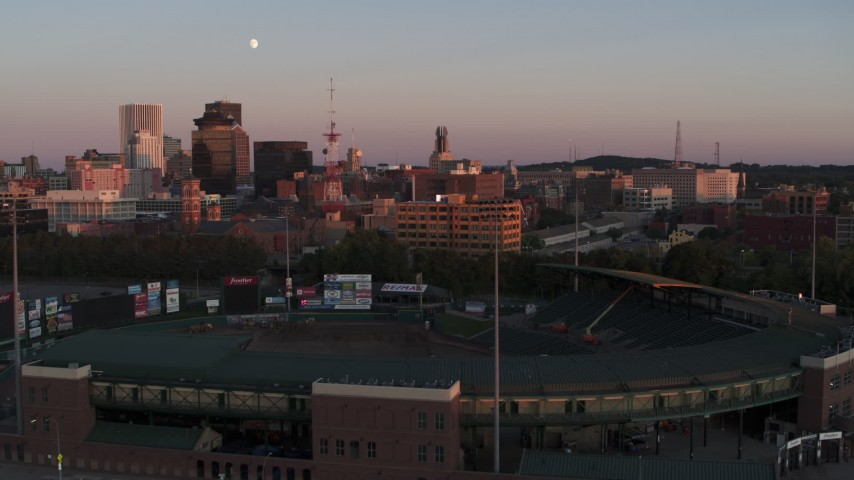 5.7K stock footage aerial video fly over baseball stadium to approach radio tower and office buildings at sunset, Downtown Rochester, New York Aerial Stock Footage | DX0002_209_048