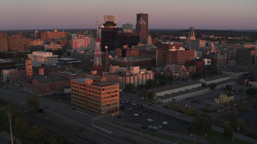 5.7K stock footage aerial video of an orbit of a radio tower and office buildings at sunset, Downtown Rochester, New York Aerial Stock Footage | DX0002_209_050