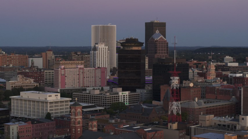 5.7K stock footage aerial video of flying by First Federal Plaza and office buildings at twilight, Downtown Rochester, New York Aerial Stock Footage | DX0002_210_001