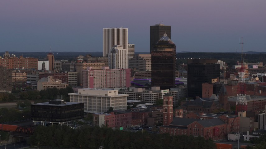 5.7K stock footage aerial video of passing by First Federal Plaza and office buildings at twilight, Downtown Rochester, New York Aerial Stock Footage | DX0002_210_002