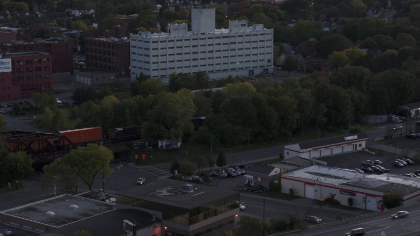5.7K stock footage aerial video of tracking a train at twilight, Downtown Rochester, New York Aerial Stock Footage | DX0002_210_003