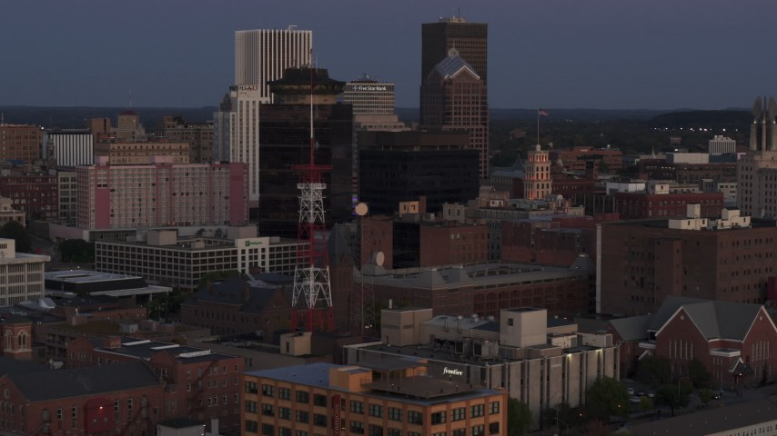 5.7K stock footage aerial video of First Federal Plaza, Legacy Tower and radio tower at twilight, Downtown Rochester, New York Aerial Stock Footage | DX0002_210_005