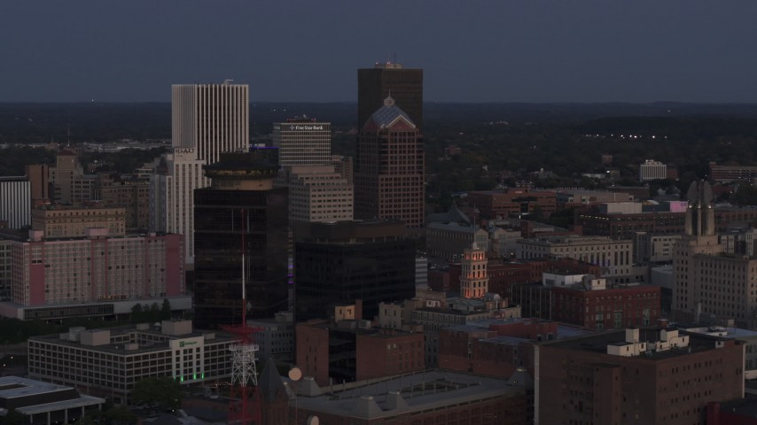 5.7K stock footage aerial video focus on Legacy Tower at twilight during orbit of skyline, Downtown Rochester, New York Aerial Stock Footage | DX0002_210_007