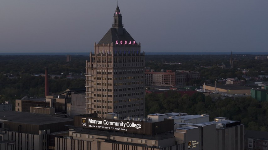 5.7K stock footage aerial video descend while focused on the top of Kodak Tower at twilight, Rochester, New York Aerial Stock Footage | DX0002_210_010