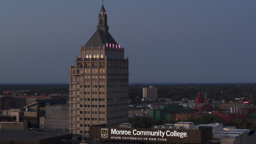 5.7K stock footage aerial video fly away from Kodak Tower at twilight and descend, Rochester, New York Aerial Stock Footage | DX0002_210_011