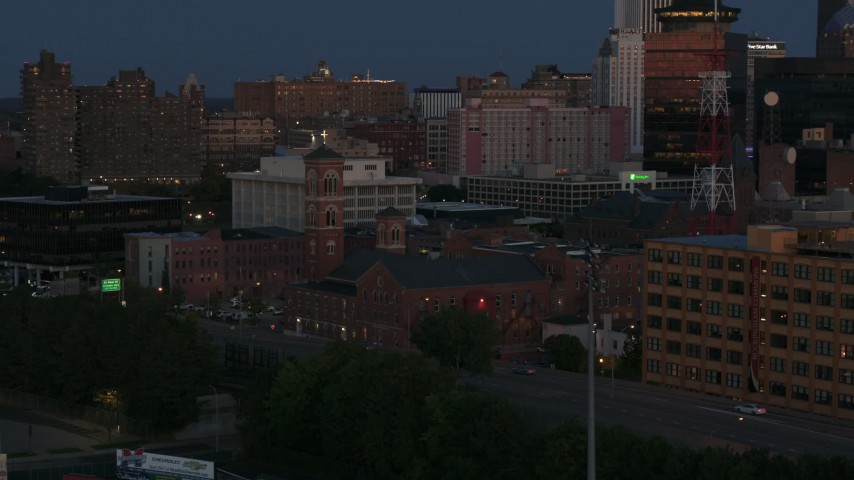 5.7K stock footage aerial video of an orbit of Spiritus Christi Church at twilight, Downtown Rochester, New York Aerial Stock Footage | DX0002_210_013