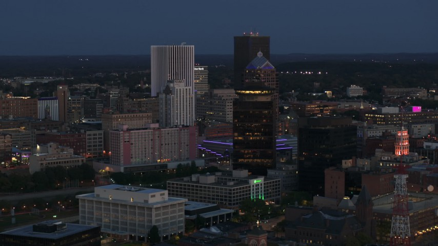 5.7K stock footage aerial video orbit the city skyline behind First Federal Plaza at twilight, Downtown Rochester, New York Aerial Stock Footage | DX0002_210_017