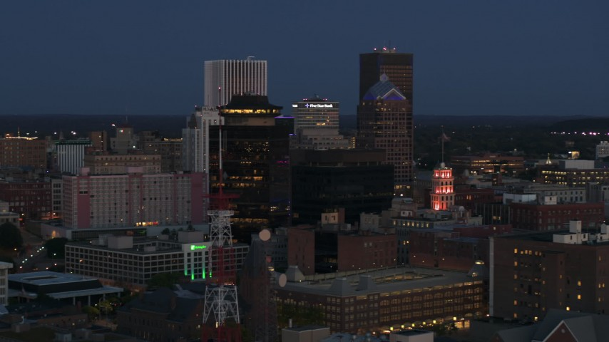 5.7K stock footage aerial video descend and orbit the city skyline behind radio tower, First Federal Plaza at twilight, Downtown Rochester, New York Aerial Stock Footage | DX0002_210_018
