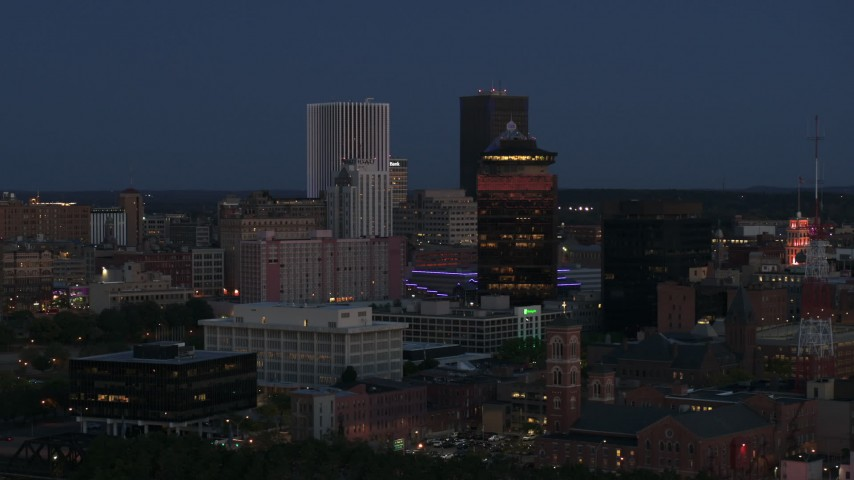 5.7K stock footage aerial video of flying by the city skyline behind First Federal Plaza at twilight, Downtown Rochester, New York Aerial Stock Footage | DX0002_210_019