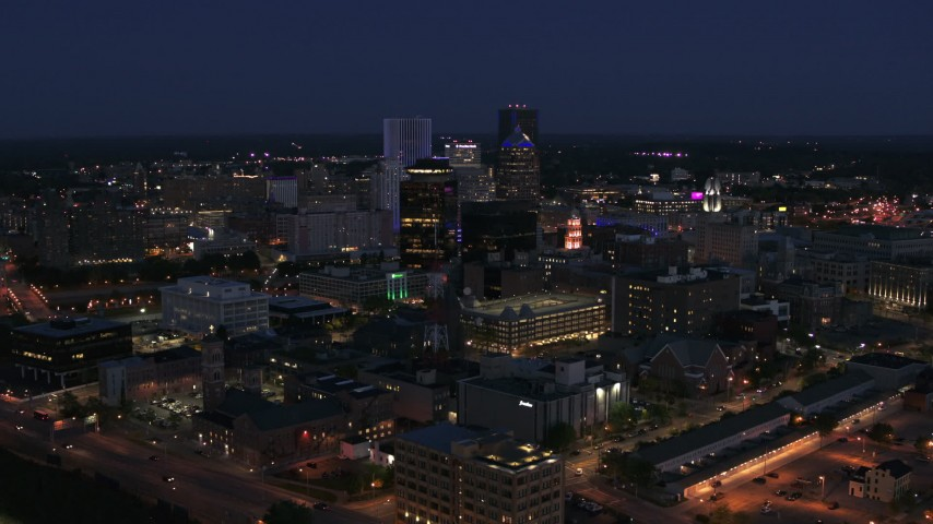 5.7K stock footage aerial video of a wide view of the city's skyline at night, Downtown Rochester, New York Aerial Stock Footage | DX0002_210_021