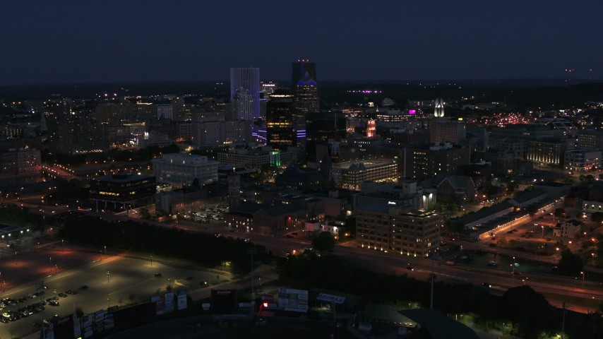 5.7K stock footage aerial video flyby and approach the city's night at twilight, Downtown Rochester, New York Aerial Stock Footage | DX0002_210_022