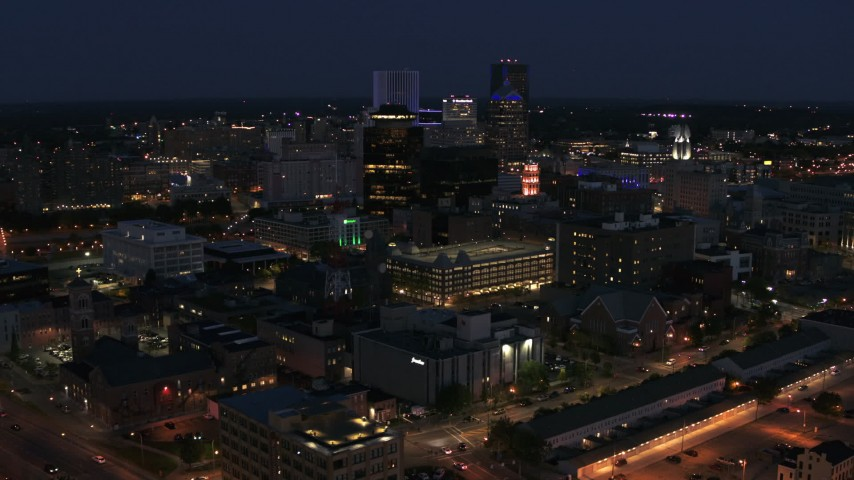 5.7K stock footage aerial video descend and fly away from the city's skyline at night, Downtown Rochester, New York Aerial Stock Footage | DX0002_210_023