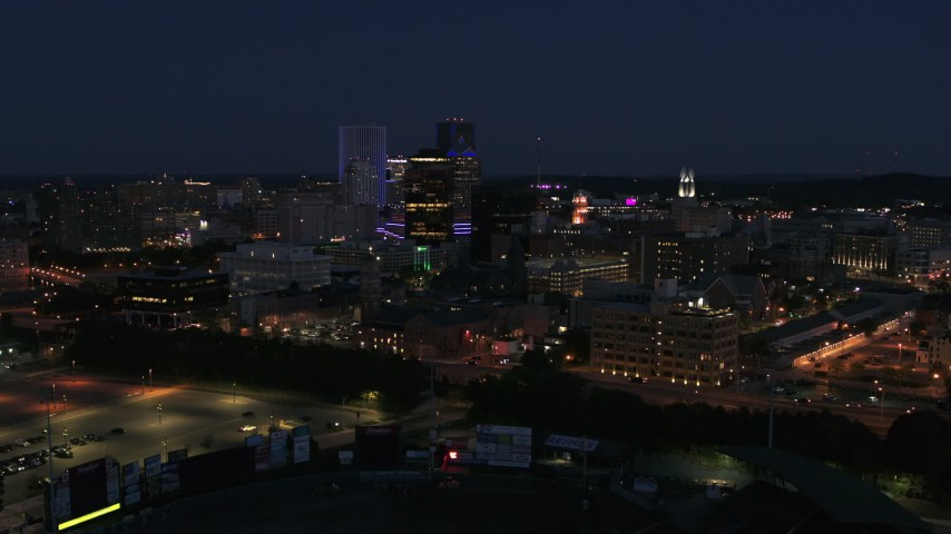 5.7K stock footage aerial video of a reverse view of the city's skyline at night, Downtown Rochester, New York Aerial Stock Footage | DX0002_210_024