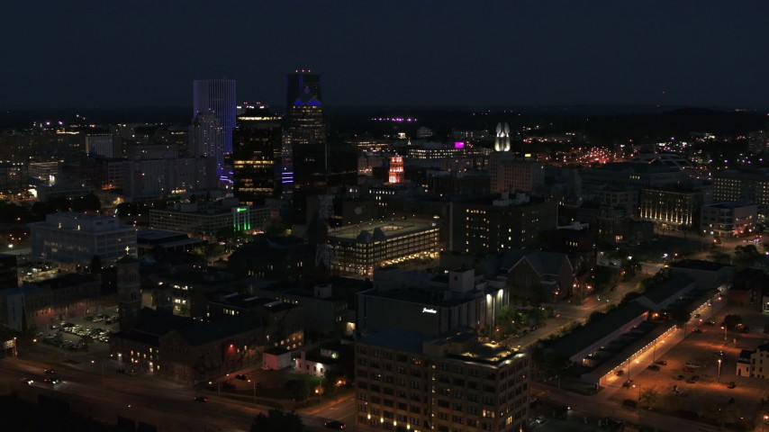 5.7K stock footage aerial video ascend and orbit office buildings at night, Downtown Rochester, New York Aerial Stock Footage | DX0002_210_028