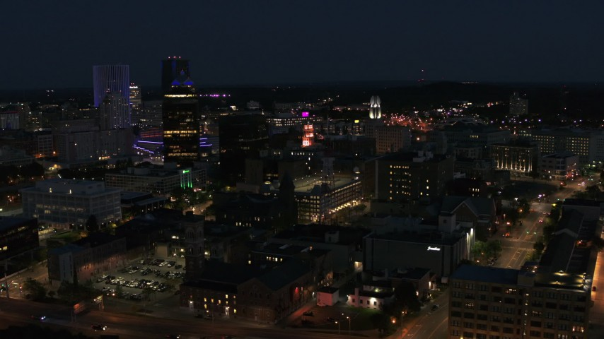 5.7K stock footage aerial video of orbiting downtown office buildings at night, Downtown Rochester, New York Aerial Stock Footage | DX0002_210_029