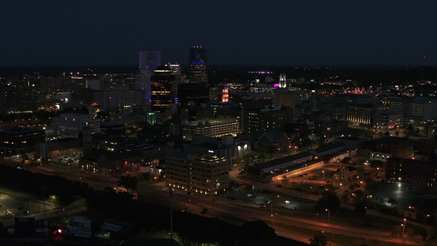 5.7K stock footage aerial video of flying away from office buildings and skyline at night, Downtown Rochester, New York Aerial Stock Footage | DX0002_210_030