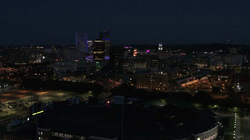 5.7K stock footage aerial video of descending toward office buildings and skyline at night, Downtown Rochester, New York Aerial Stock Footage | DX0002_210_031