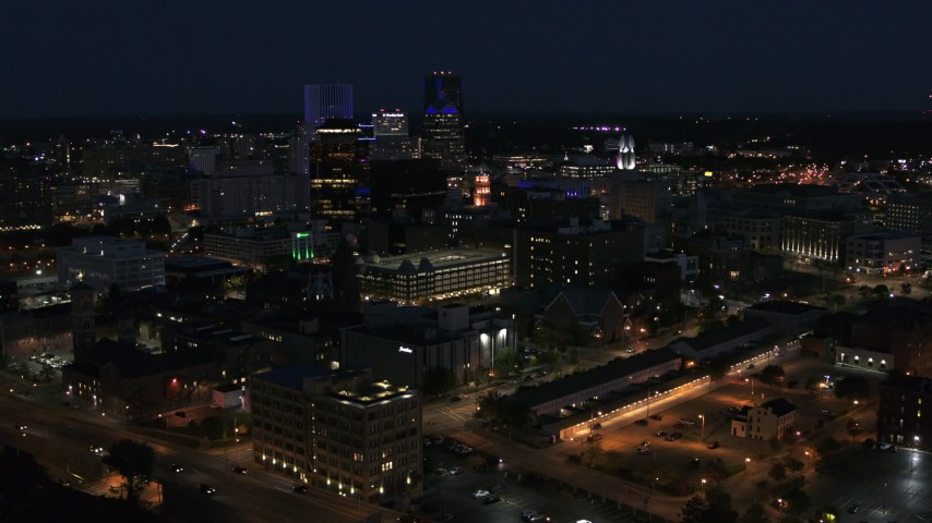 5.7K stock footage aerial video a view of office buildings and skyline during descent at night, Downtown Rochester, New York Aerial Stock Footage | DX0002_210_034