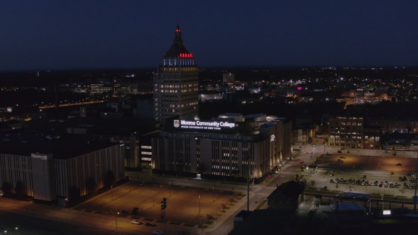 5.7K stock footage aerial video fly away from Kodak Tower and college at night, and descend, Rochester, New York Aerial Stock Footage | DX0002_210_036