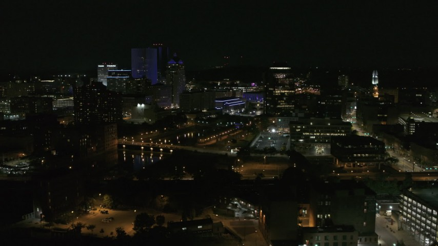 5.7K stock footage aerial video of the Genesee River and skyline at night, Downtown Rochester, New York Aerial Stock Footage | DX0002_210_037