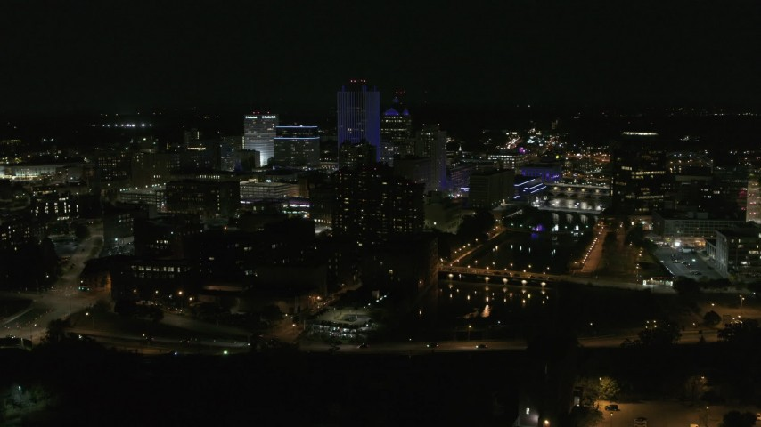 5.7K stock footage aerial video stationary view of the Genesee River and skyline at night, Downtown Rochester, New York Aerial Stock Footage | DX0002_210_039