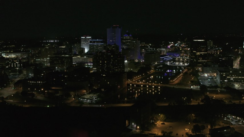 5.7K stock footage aerial video of flying by the Genesee River and skyline at night, Downtown Rochester, New York Aerial Stock Footage | DX0002_210_040