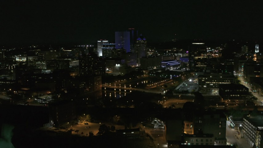 5.7K stock footage aerial video of flying away from the Genesee River and skyline at night, Downtown Rochester, New York Aerial Stock Footage | DX0002_210_041