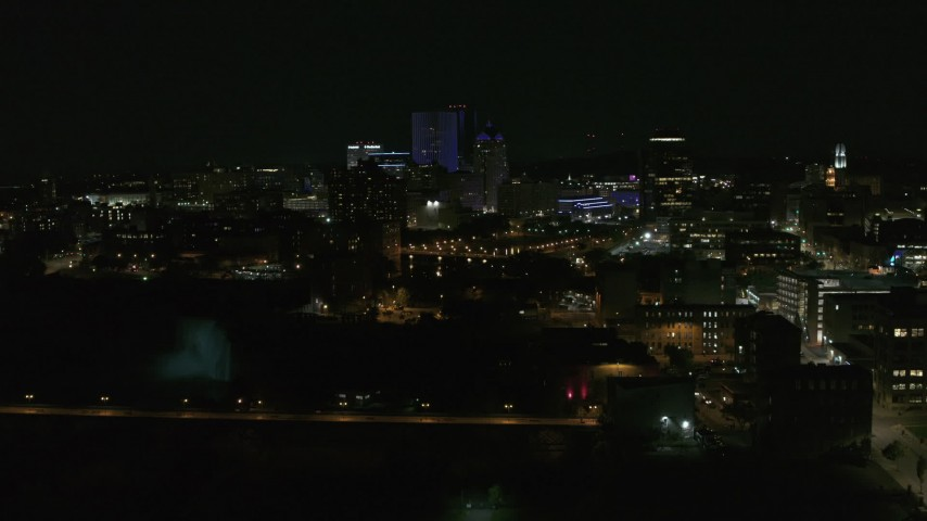5.7K stock footage aerial video of approaching the Genesee River and skyline at night, Downtown Rochester, New York Aerial Stock Footage | DX0002_210_042