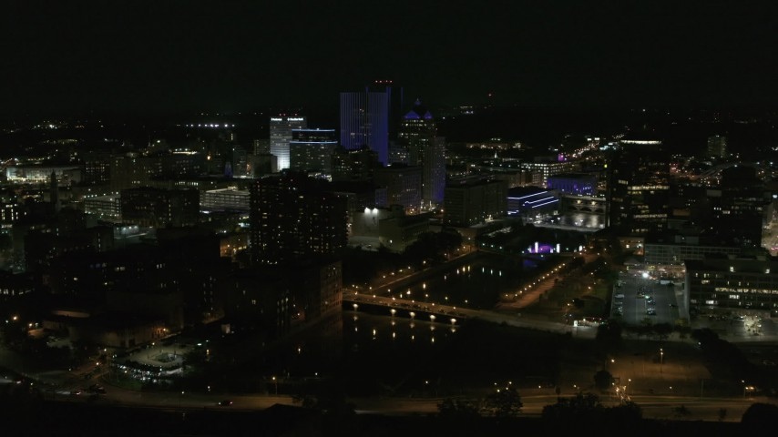 5.7K stock footage aerial video of approaching the city's skyline beside the Genesee River at night, Downtown Rochester, New York Aerial Stock Footage | DX0002_210_043