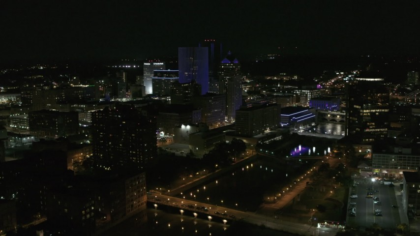 5.7K stock footage aerial video of orbiting the city's skyline beside the Genesee River at night, Downtown Rochester, New York Aerial Stock Footage | DX0002_210_044