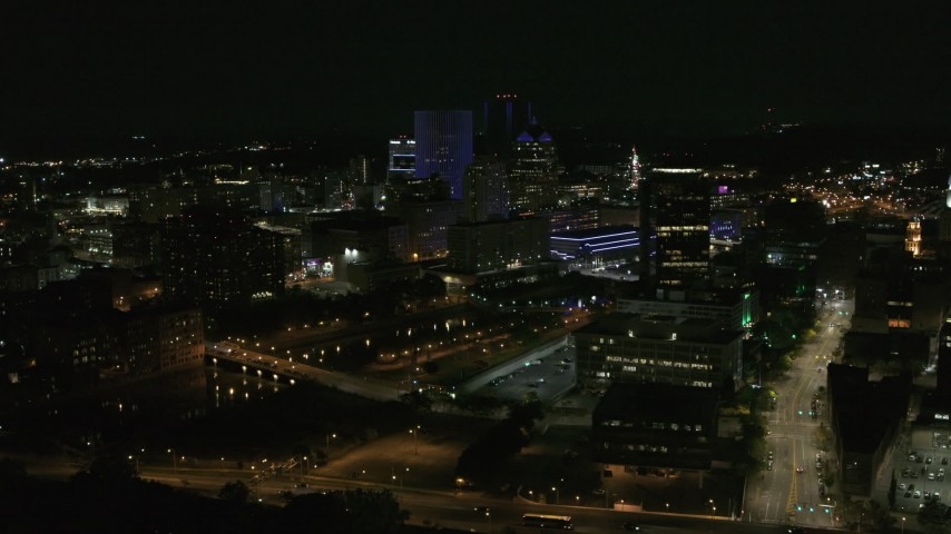 5.7K stock footage aerial video fly away from and orbit city's skyline beside the Genesee River at night, Downtown Rochester, New York Aerial Stock Footage | DX0002_210_045