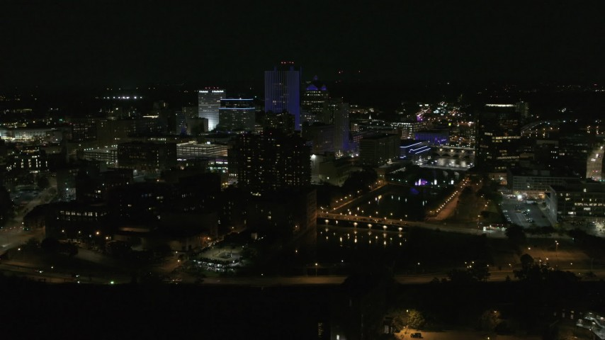 5.7K stock footage aerial video of a wide orbit of city's skyline beside the Genesee River at night, Downtown Rochester, New York Aerial Stock Footage | DX0002_210_046