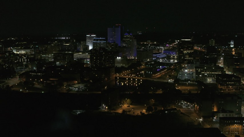 5.7K stock footage aerial video of circling the city's skyline by the Genesee River at night, Downtown Rochester, New York Aerial Stock Footage | DX0002_210_048