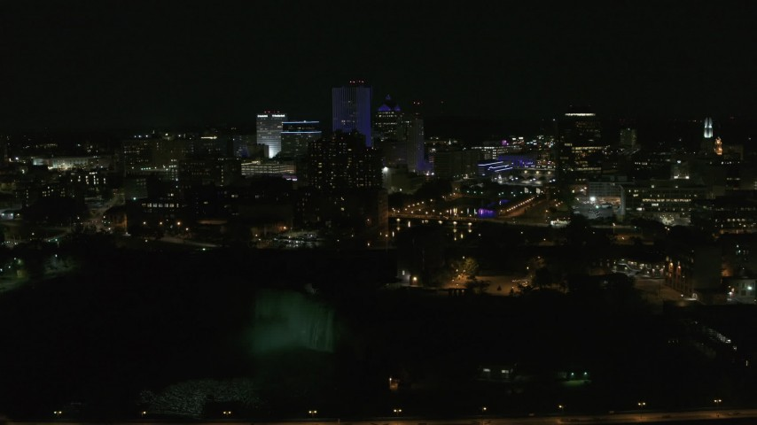 5.7K stock footage aerial video of a view of the city's skyline, the Genesee River, and High Falls at night, Downtown Rochester, New York Aerial Stock Footage | DX0002_210_049
