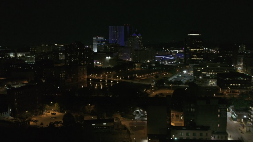 5.7K stock footage aerial video of flying by the Genesee River and skyline at night, Downtown Rochester, New York Aerial Stock Footage | DX0002_210_050