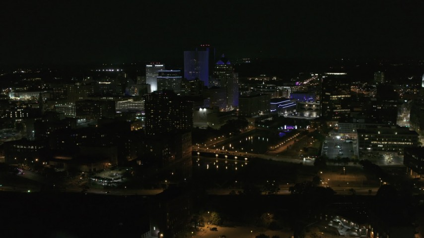 5.7K stock footage aerial video of a reverse view of the Genesee River and skyline at night, Downtown Rochester, New York Aerial Stock Footage | DX0002_210_051