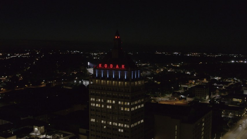 5.7K stock footage aerial video of orbiting the top of Kodak Tower at night, Rochester, New York Aerial Stock Footage | DX0002_210_054