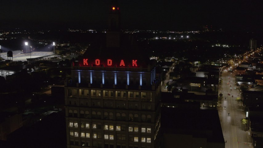 5.7K stock footage aerial video of approaching the top of Kodak Tower at night, Rochester, New York Aerial Stock Footage   DX0002_210_055