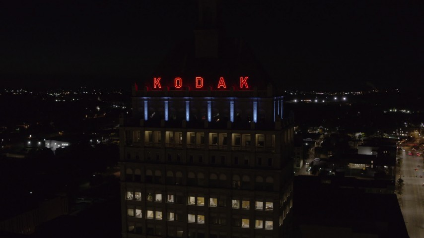 5.7K stock footage aerial video of flying away from the top of Kodak Tower at night, Rochester, New York Aerial Stock Footage | DX0002_210_056