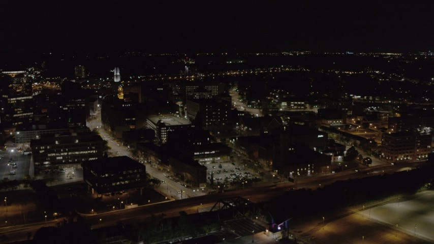 5.7K stock footage aerial video fly away from and by office buildings and the Inner Loop at night, Downtown Rochester, New York Aerial Stock Footage | DX0002_210_058