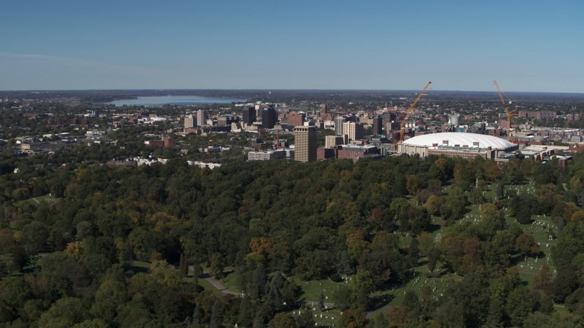 5.7K stock footage aerial video of Carrier Dome and Downtown Syracuse, New York seen from cemetery Aerial Stock Footage | DX0002_211_004