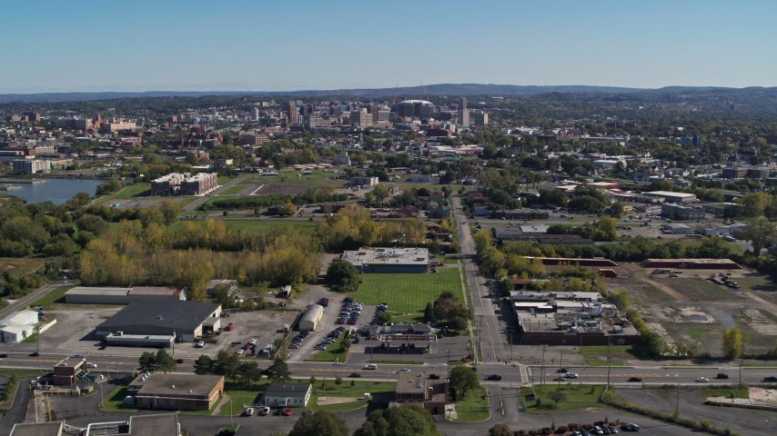 5.7K stock footage aerial video of Downtown Syracuse, New York seen from across the city Aerial Stock Footage | DX0002_211_014