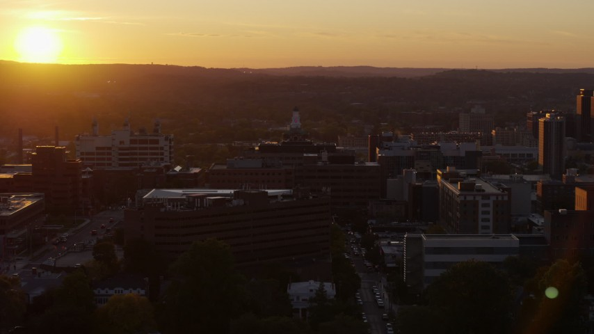 5.7K stock footage aerial video of orbiting Crouse Hospital in Downtown Syracuse at sunset, New York Aerial Stock Footage | DX0002_214_032
