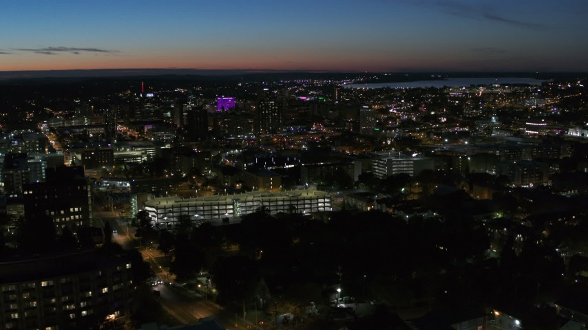 5.7K stock footage aerial video of city buildings lit up for the evening in Downtown Syracuse at twilight, New York Aerial Stock Footage | DX0002_215_001