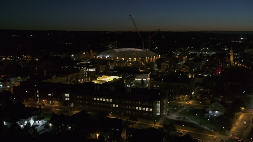 5.7K stock footage aerial video of Carrier Dome and Syracuse University at twilight, Syracuse, New York Aerial Stock Footage | DX0002_215_018