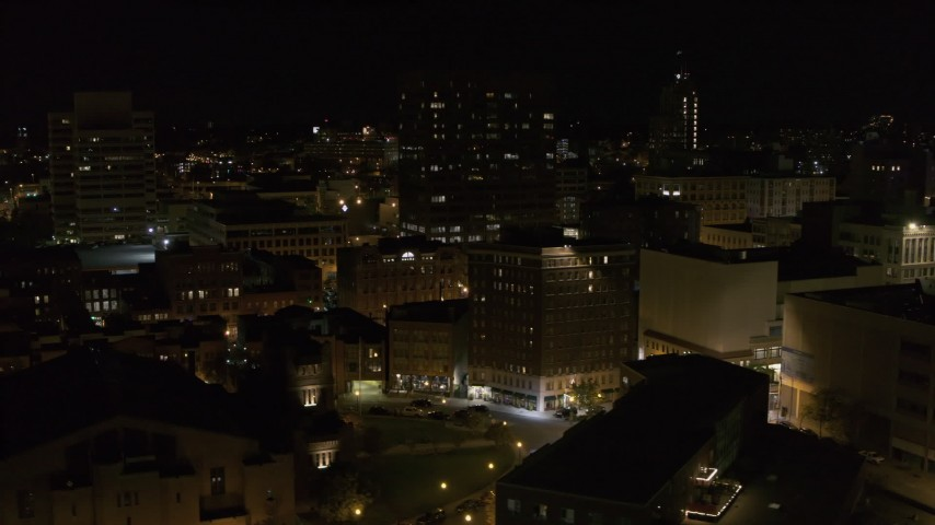 5.7K stock footage aerial video orbit One Lincoln Center and reveal apartment building at night, Downtown Syracuse, New York Aerial Stock Footage | DX0002_215_039