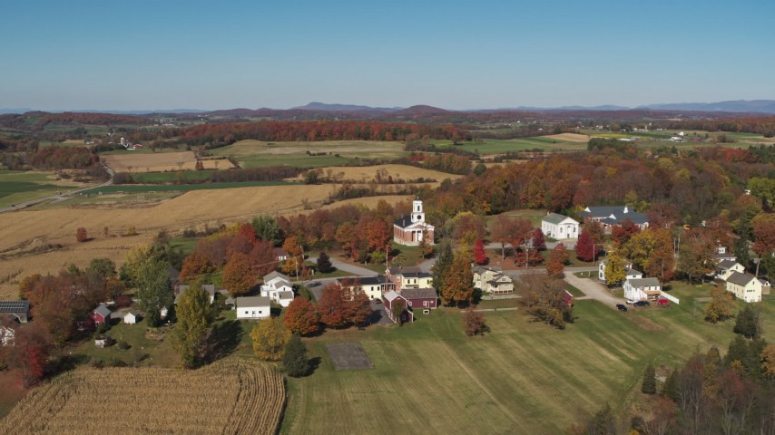 5.7K stock footage aerial video orbit a church in the small town of Orwell, Vermont, farm fields in background Aerial Stock Footage | DX0002_217_002